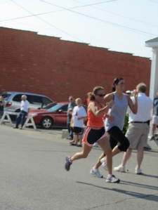 This picture has nothing to do with this post. It was taken a couple years ago when this tall lady tried to pass me at the end of a race. Not happening. This NANA was gonna kick her butt! (I beat her)